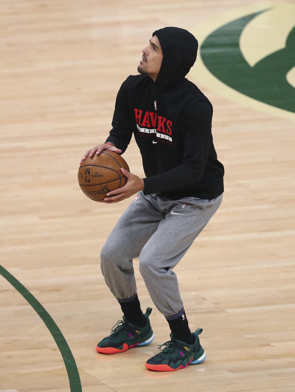 Atlanta Hawks guard Trae Young tests out the bone bruise in his right ankle two hours before tipoff against the Milwaukee Bucks in Game 5 of the Eastern Conference finals in the NBA basketball playoffs Thursday, July 1, 2021, in Milwaukee. (Curtis Compton/Atlanta Journal-Constitution via AP)