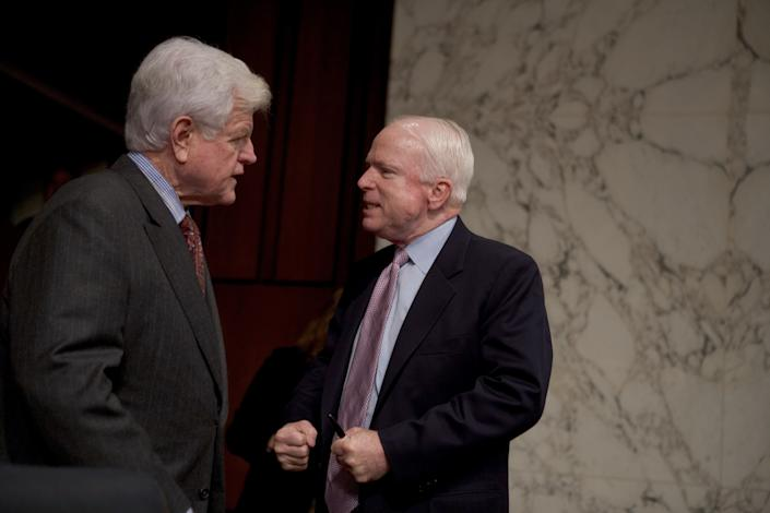 Sen. Ted Kennedy (D-Mass.) confers with McCain before the start of a Senate Armed Services Committee hearing on Capitol Hill on Feb. 10, 2005.