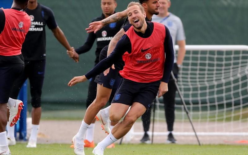 Harry Kane celebrates scoring in England training - PA
