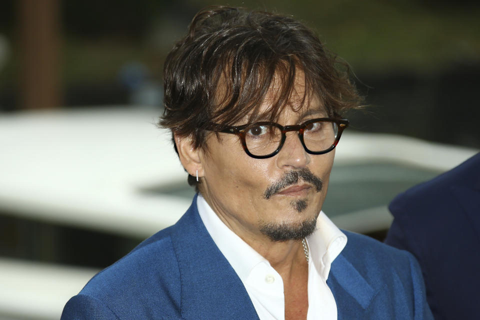 Actor Johnny Depp poses for photographers upon arrival for the photo call of the film 'Waiting For The Barbarians' at the 76th edition of the Venice Film Festival in Venice, Italy, Friday, Sept. 6, 2019. (Photo by Joel C Ryan/Invision/AP)