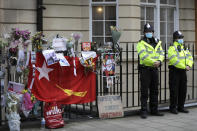 Police officers stand outside the Myanmar Embassy in London, Thursday, April 8, 2021. Newspaper reports say the embassy was taken over by members of the country's new military regime Wednesday evening. (AP Photo/Kirsty Wigglesworth)
