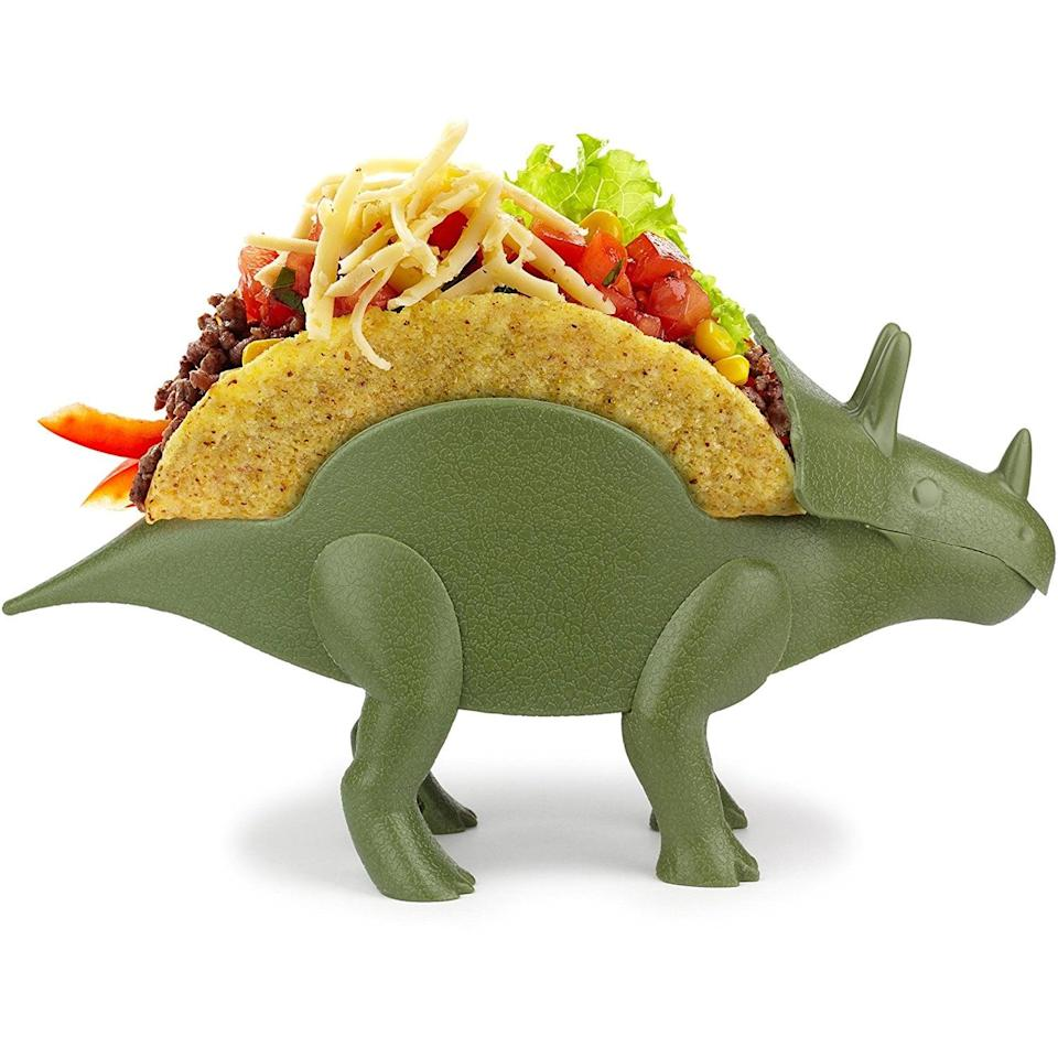 <p>Because this <span>TriceraTACO Taco Holder</span> ($12) is the perfect accessory for Taco Tuesday. Duh. </p>