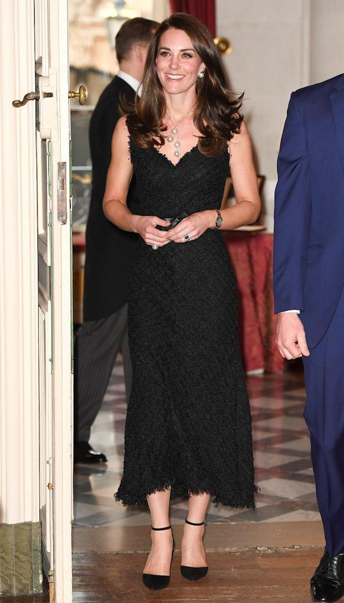 """<p>Kate Middleton looked chic at the British Embassy in Paris in a black tweed dress, but some thought it was odd the Duchess wore black. Royals typically <a href=""""https://www.harpersbazaar.com/celebrity/latest/g20651504/royal-family-rules-etiquette/?slide=17"""" rel=""""nofollow noopener"""" target=""""_blank"""" data-ylk=""""slk:reserve the color for periods of mourning and somber occasions"""" class=""""link rapid-noclick-resp"""">reserve the color for periods of mourning and somber occasions</a>, such as Remembrance Day. </p>"""