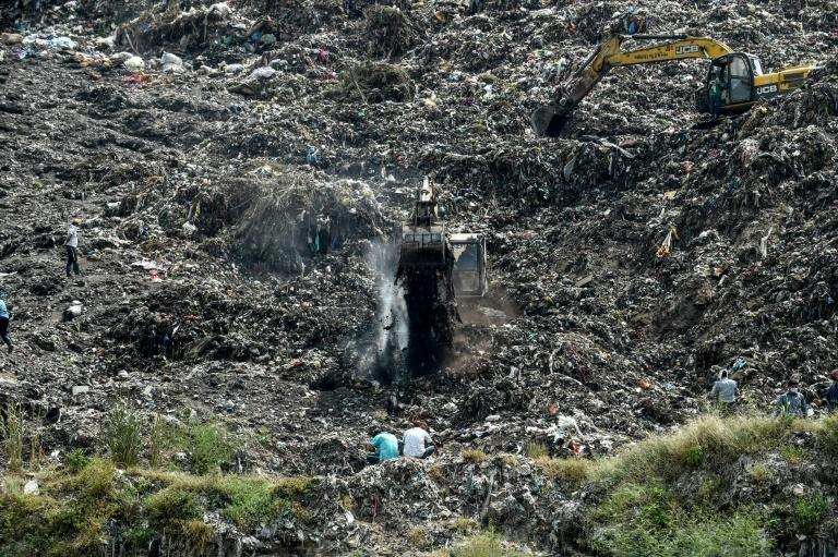 Rescuers dig through Indian trash dump for 12-year-old 'rag picker'