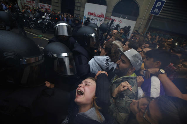 <p>A girls grimaces as Spanish National Police pushes away Pro-referendum supporters outside the Ramon Llull school assigned to be a polling station by the Catalan government in Barcelona, Spain, 1 Oct. 2017. (Photo: Emilio Morenatti/AP) </p>