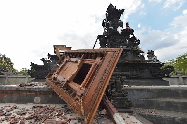 <p>Damage caused by the recent earthquakes to a Hindu temple is pictured in Pemenang, northern Lombok island on Aug. 9, 2018. (Photo: Adek Berry/AFP/Getty Images) </p>