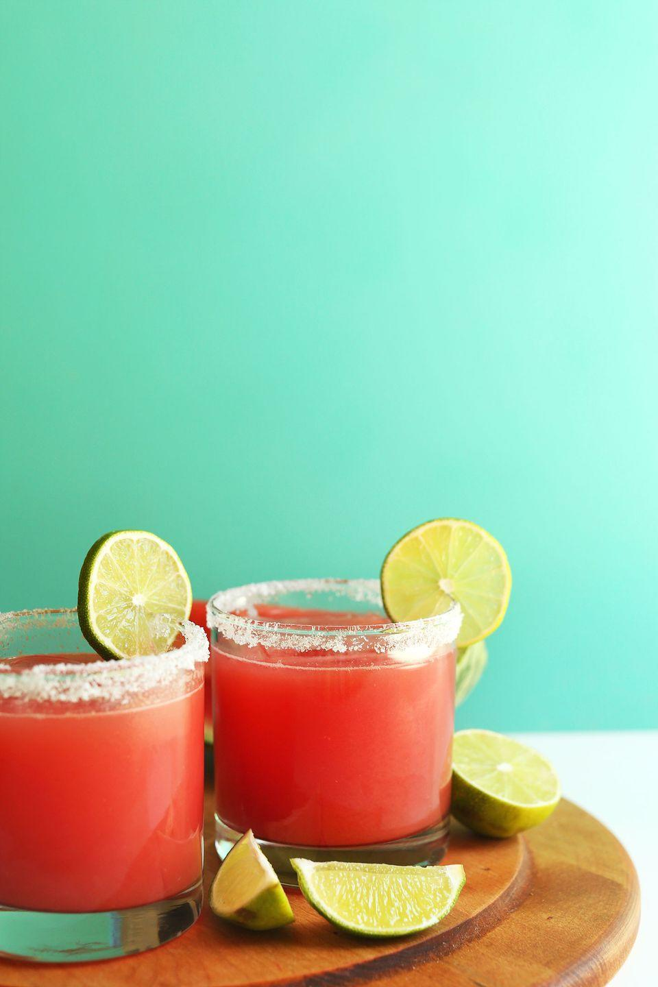 """<p>Adding tequila and lime to watermelon juice makes for an easy margarita.</p><p><strong>Get the recipe at <a href=""""https://minimalistbaker.com/best-watermelon-margaritas-3-ingredients/"""" rel=""""nofollow noopener"""" target=""""_blank"""" data-ylk=""""slk:Minimalist Baker"""" class=""""link rapid-noclick-resp"""">Minimalist Baker</a>.</strong></p><p><strong><strong><a class=""""link rapid-noclick-resp"""" href=""""https://go.redirectingat.com?id=74968X1596630&url=https%3A%2F%2Fwww.walmart.com%2Fip%2FInstant-Pot-Ace-60-Cooking-Blender%2F626991948&sref=https%3A%2F%2Fwww.thepioneerwoman.com%2Ffood-cooking%2Fmeals-menus%2Fg32147587%2Fwatermelon-drink-recipes%2F"""" rel=""""nofollow noopener"""" target=""""_blank"""" data-ylk=""""slk:SHOP BLENDERS"""">SHOP BLENDERS</a></strong><br></strong></p>"""