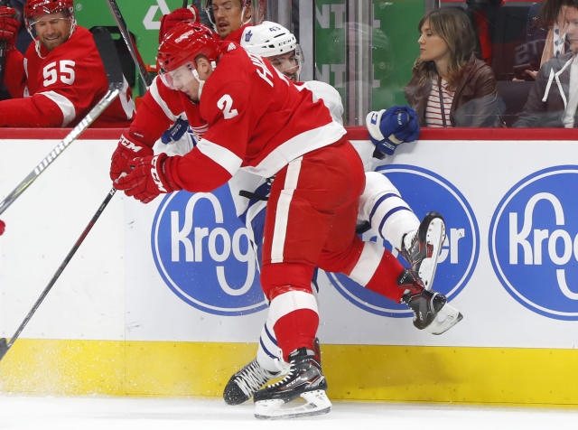 Detroit Red Wings defenseman Joe Hicketts (2) checks Toronto Maple Leafs center Nazem Kadri during the first period of an NHL hockey game Thursday, Oct. 11, 2018, in Detroit. (AP Photo/Paul Sancya)