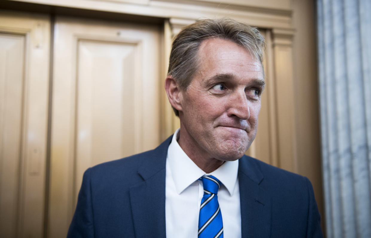 Republican Sen. Jeff Flake speaks with reporters after a vote in the Capitol in July. (Photo: Bill Clark/CQ Roll Call via Getty Images)
