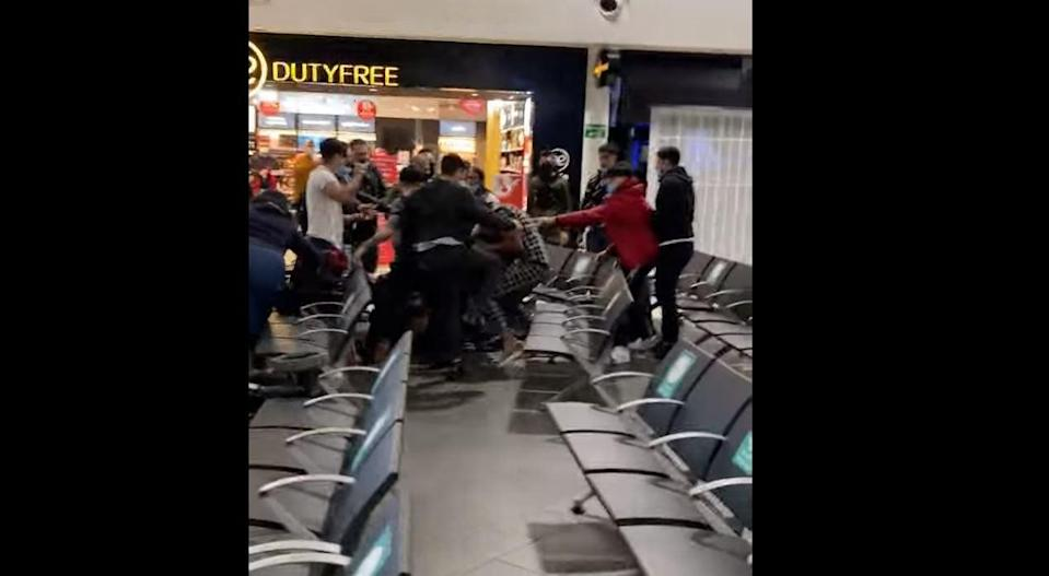 Video of the brawl at Luton Airport was uploaded to social media by other passengers (Fink Finker/Youtube)