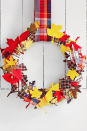 """<p>Plaid shirts and autumn leaves go together like Thanksgiving and turkey! We love the idea of celebrating both of those fall staples in one cheerful wreath. <strong><br></strong></p><p><strong>Make the wreath: </strong>Trace leaf stencils onto double-stick fusible webbing, then fuse them to <a href=""""https://www.amazon.com/Michael-Miller-EO-087-Collection-Multicolor/dp/B005GRFJIK?linkCode=ogi&tag=syn-yahoo-20&ascsubtag=%5Bartid%7C10050.g.2610%5Bsrc%7Cyahoo-us"""" rel=""""nofollow noopener"""" target=""""_blank"""" data-ylk=""""slk:plaid fabric"""" class=""""link rapid-noclick-resp"""">plaid fabric</a> and cut out leaf shapes. Next, fuse the cutout leaves to felt, and cut out once more. Finally, wrap a foam wreath form with <a href=""""https://www.amazon.com/Plaid-Canvas-Wired-Ribbon-Orange/dp/B078T2DZQ4?linkCode=ogi&tag=syn-yahoo-20&ascsubtag=%5Bartid%7C10050.g.2610%5Bsrc%7Cyahoo-us"""" rel=""""nofollow noopener"""" target=""""_blank"""" data-ylk=""""slk:ribbon"""" class=""""link rapid-noclick-resp"""">ribbon</a> and attach the leaves with push-pins or hot glue, mixing the plaid and felt sides. Hang with a strip of plaid fabric.</p>"""