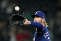 Texas Rangers starting pitcher Mike Foltynewicz gets a new ball after giving up a solo home run to Seattle Mariners' J.P. Crawford during the seventh inning of a baseball game Saturday, May 29, 2021, in Seattle. (AP Photo/Elaine Thompson)