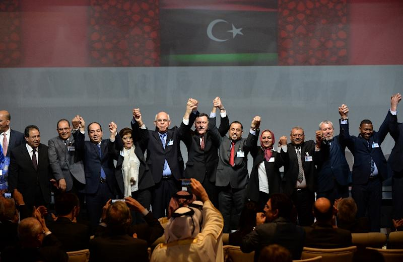 Libya's GNC deputy president Saleh el-Makhzoum (C-R) and other officials celebrate after signing a deal on a unity government on December 17, 2015, in the Moroccan city of Skhirat (AFP Photo/Fadel Senna)