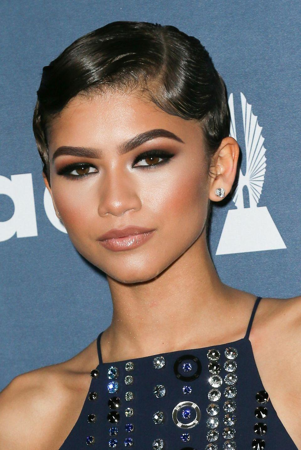 <p>Zendaya's subtle finger waves and a dark smoky eye embodied 1920s beauty at the 27th GLAAD Beauty Awards.</p>