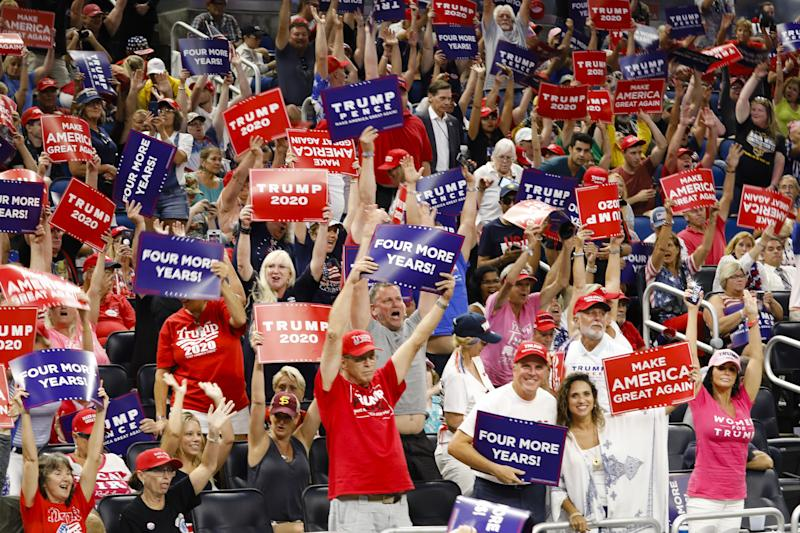 ORLANDO, USA - JUNE 18: Supporters hold placards during a rally at the Amway Center in Orlando, Florida, United States on June 18, 2019. President Donald Trump officially launches his 2020 campaign. (Photo by Eva Marie Uzcategui T./Anadolu Agency/Getty Images)