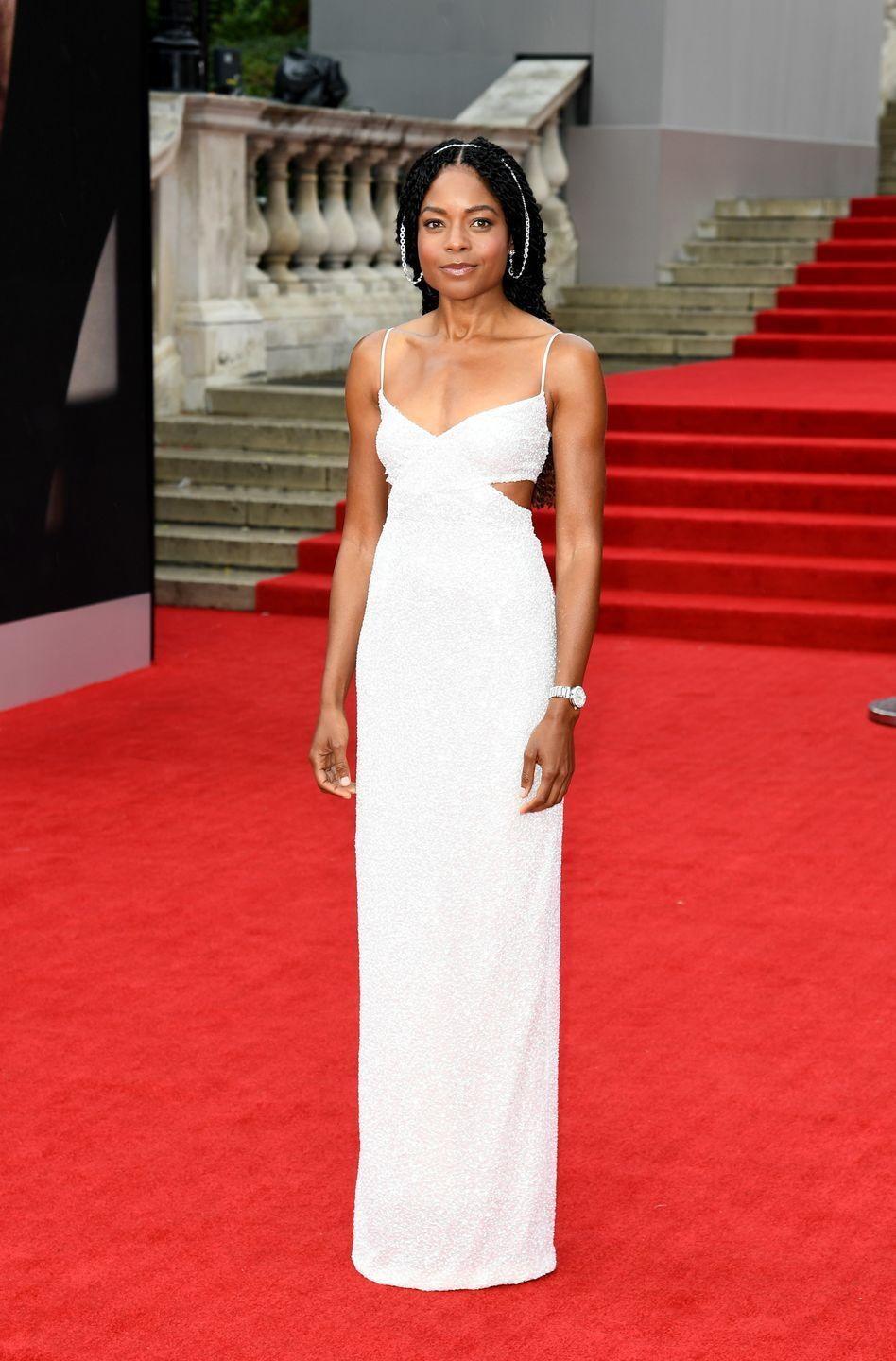 <p>Naomie Harris wore a white Michael Kors column dress with an Omega watch, and a delicate silver chain through her hair. </p>