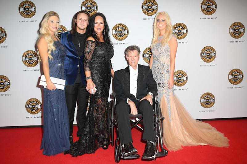 Third from left, Mary Travis and artist Randy Travis, seated, with family on the red carpet of the Country Music Hall of Fame Medallion Ceremony at the Country Music Hall of Fame and Museum on Sunday, October 16, 2016 in Nashville, Tenn. (Photo by Laura Roberts/Invision/AP)