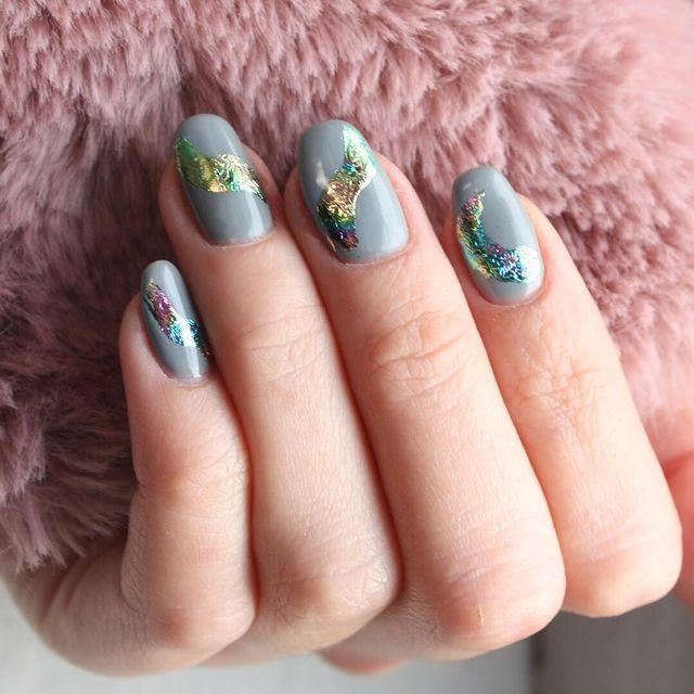 """<p>Ask your nail tech to add metallic foils to your manicure like this oil-spill pattern. </p><p><a href=""""https://www.instagram.com/p/BtxBpRnnj6t/"""" rel=""""nofollow noopener"""" target=""""_blank"""" data-ylk=""""slk:See the original post on Instagram"""" class=""""link rapid-noclick-resp"""">See the original post on Instagram</a></p>"""