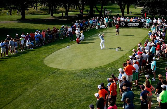Rory McIlroy hits off the 14th tee during the second round of the World Golf Championships-Bridgestone Invitational at Firestone Country Club South Course on August 1, 2014 in Akron, Ohio (AFP Photo/Gregory Shamus)