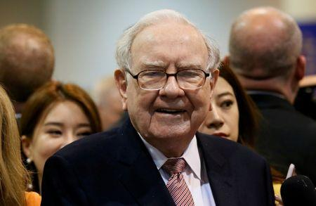 FILE PHOTO: Berkshire Hathaway CEO Warren Buffett visits the BNSF booth before the Berkshire Hathaway annual meeting in Omaha
