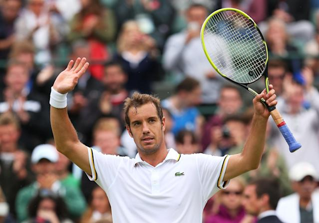 LONDON, ENGLAND - JUNE 27: Richard Gasquet of France celebrates match point during his Gentlemen's Singles second round match against Go Soeda of Japan on day four of the Wimbledon Lawn Tennis Championships at the All England Lawn Tennis and Croquet Club on June 27, 2013 in London, England. (Photo by Julian Finney/Getty Images)