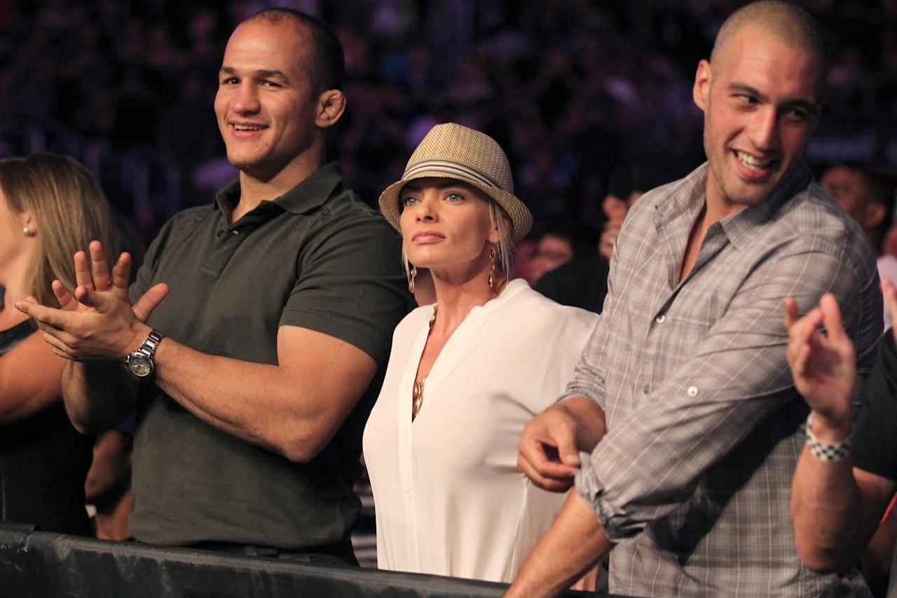 COMMERCIAL IMAGE - UFC Heavyweight Champion Junior Dos Santos, left, Jaime Pressly, center, and guest attend the UFC on Fox event at Staples Center on Saturday, Aug. 4, 2012, in Los Angeles. (Photo by Matt Sayles/Invision/AP Images)