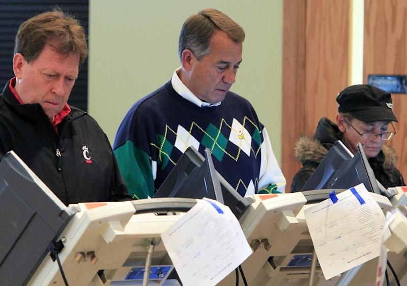 Speaker John Boehner, R-Ohio, center, votes at Ronald Reagan Lodge, Tuesday, Nov. 6, 2012, in West Chester, Ohio.  After a grinding presidential campaign, Americans head into polling places across the country.  (AP Photo/Al Behrman)