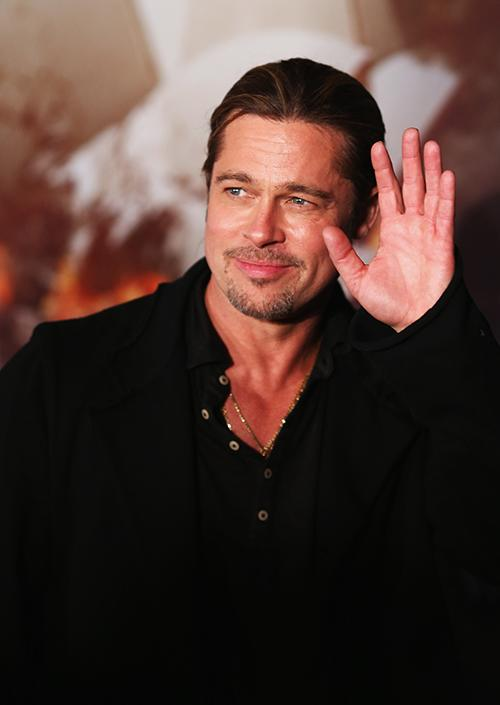 Brad Pitt arrived in Sydney for the Australian premiere of his latest action blockbuster, 'World War Z', a film about a zombie apolcalypse. While it was rumoured his son Pax was travelling with him to Australia, Brad hit the red carpet with only 'WWZ' director Marc Forster (and a few hundred screaming fans and media ) to keep him company.