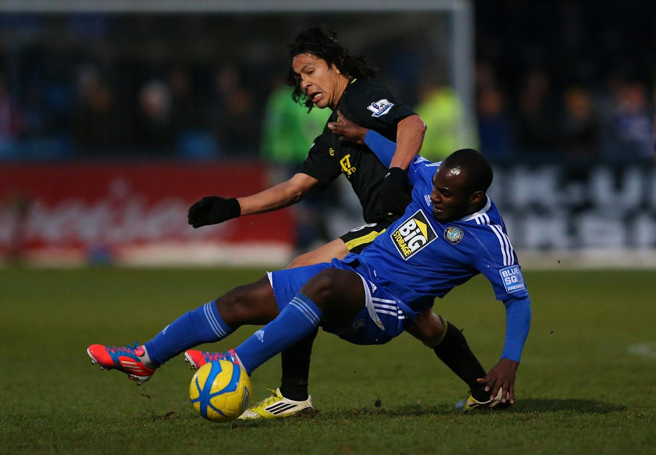 MACCLESFIELD, ENGLAND - JANUARY 26:  Roger Espinoza of Wigan Athletic clashes with Dean McDonald of Macclesfield Town during the Budweiser FA Cup fourth round match between Macclesfield Town and Wigan Athletic at Moss Rose Ground on January 26, 2013 in Macclesfield, England.  (Photo by Alex Livesey/Getty Images)