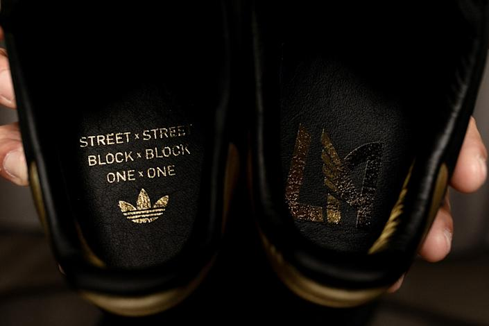 """Interior details of the Adidas Originals X LAFC Samba sneaker include the team crest in one shoe and its rallying cry in the other. <span class=""""copyright"""">(Adidas Creators Network)</span>"""