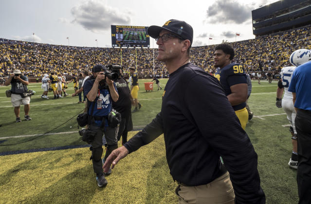 Michigan head coach Jim Harbaugh walks off the field after an NCAA college football game against Air Force in Ann Arbor, Mich., Saturday, Sept. 16, 2017. Michigan won 29-13. (AP Photo/Tony Ding)