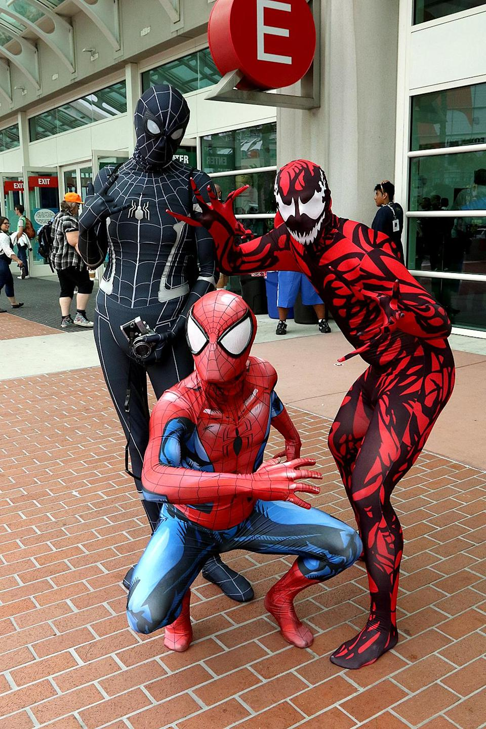 <p>Cosplayers dressed as various Spider-Men at Comic-Con International on July 20, 2018, in San Diego. (Photo: Angela Kim/Yahoo Entertainment) </p>