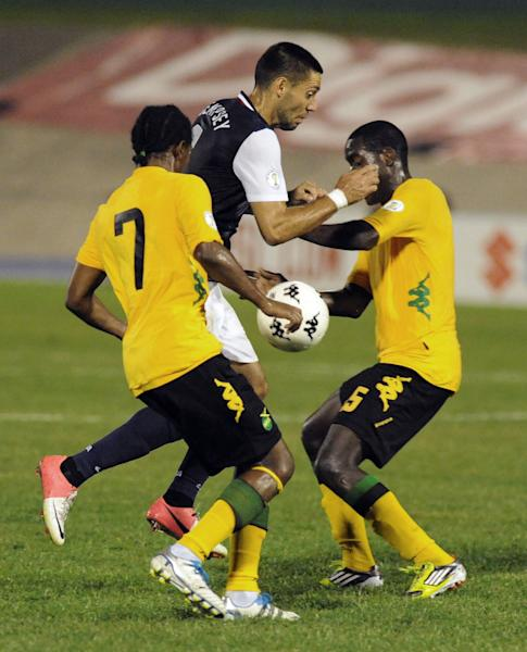 United States' Clint Dempsey, center, is challenged by Jamaica's Jason Morrison, left, and Jevaughn Watson during a 2014 World Cup qualifying soccer match in Kingston, Jamaica, Friday, Sept. 7, 2012. (AP Photo/Collin Reid)