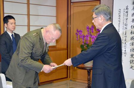 Lt. Gen. Lawrence Nicholson (2nd L), top commander of U.S. military forces in Okinawa, receives a letter of protest from Okinawa Governor Takeshi Onaga during their meeting at the prefectural government office in Naha, Okinawa prefecture, Japan, in this photo taken by Kyodo on November 20, 2017. Mandatory credit Kyodo/via REUTERS