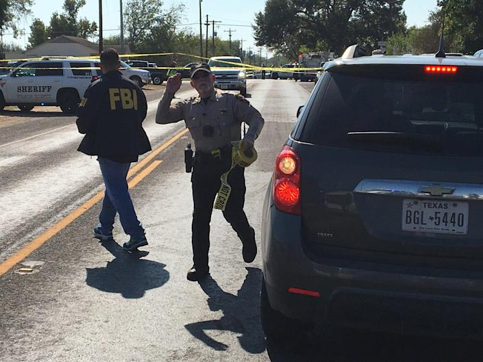 <p>FBI officials arrive at the site of a mass shooting in Sutherland Springs, Texas, Nov. 5, 2017, in this picture obtained via social media. (Max Massey/ KSAT 12/via Reuters) </p>