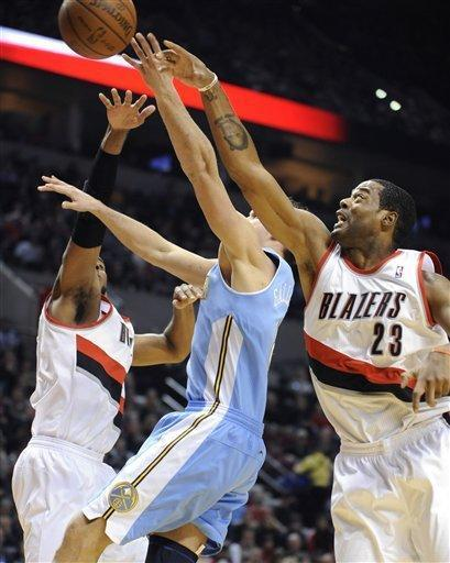 Denver Nuggets' Danilo Gallinari (8) shoots against Portland Trail Blazers' Marcus Camby (23) and LaMarcus Aldridge, left, during the first half of an NBA basketball game in Portland, Ore., Thursday, Dec 29, 2011. (AP Photo/Greg Wahl-Stephens)