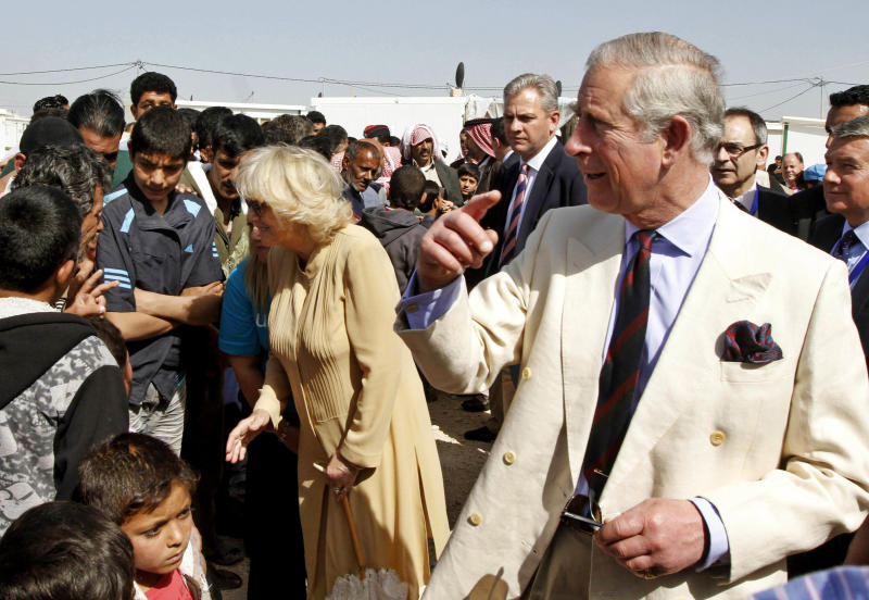 Britain's Prince Charles, right, and his wife Camilla Parker-Bowles, the Duchess of Cornwall, speak to Syrian refugees during their visit to the King Abdullah Park for Syrian Refugees in Ramtha city north of Amman, Jordan, Wednesday, March 13, 2013. Prince Charles and his wife Duchess Camilla are in Amman on a three-day official visit. (AP Photo/Jamal Nasrallah, Pool)