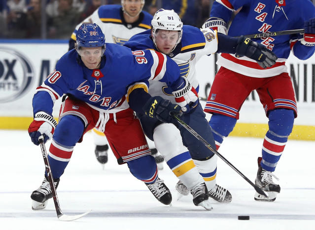 New York Rangers' Vladislav Namestnikov, left and St. Louis Blues' Vladimir Tarasenko, both of Russia, chase the puck during the first period of an NHL hockey game Saturday, March 17, 2018, in St. Louis. (AP Photo/Jeff Roberson)