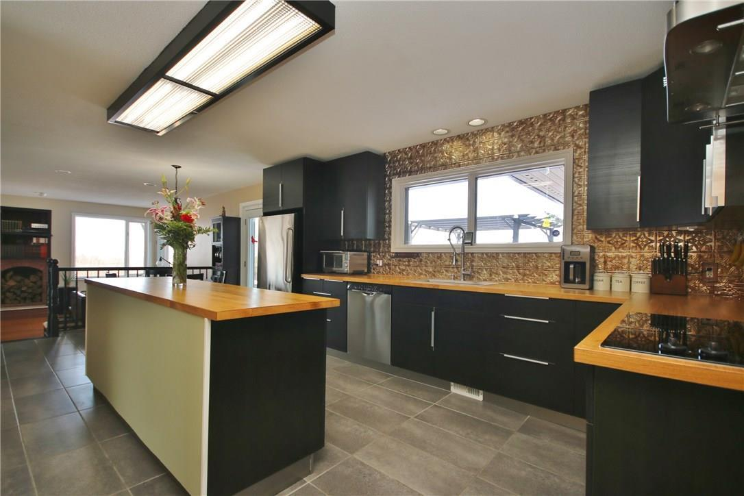"""<p><a rel=""""nofollow"""" href=""""https://www.zoocasa.com/ottawa-on-real-estate/5004937-2955-quillivan-lane-ottawa-on-k4c1a9-1087340"""">2955 Quillivan Drive, Ottawa, Ont.</a><br /> The kitchen includes the fridge, built-in cooktop, dishwasher, and combination microwave range hood, and can be accessed via a small elevator from the garage.<br /> (Photo: Zoocasa) </p>"""