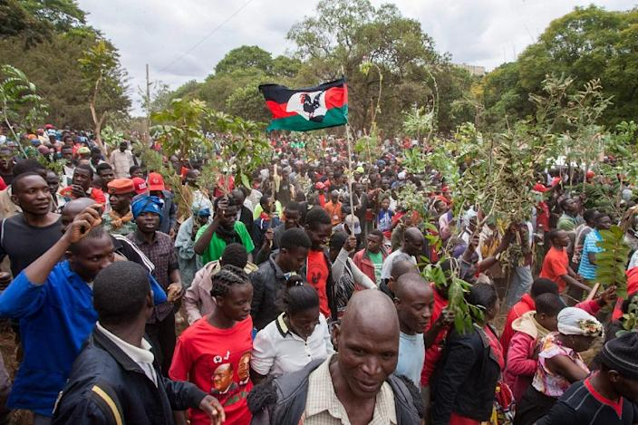 Supporters of the opposition Malawi Congress Party their leader Lazarus Chakwera was robbed of victory in a May 21 election (AFP Photo/AMOS GUMULIRA)