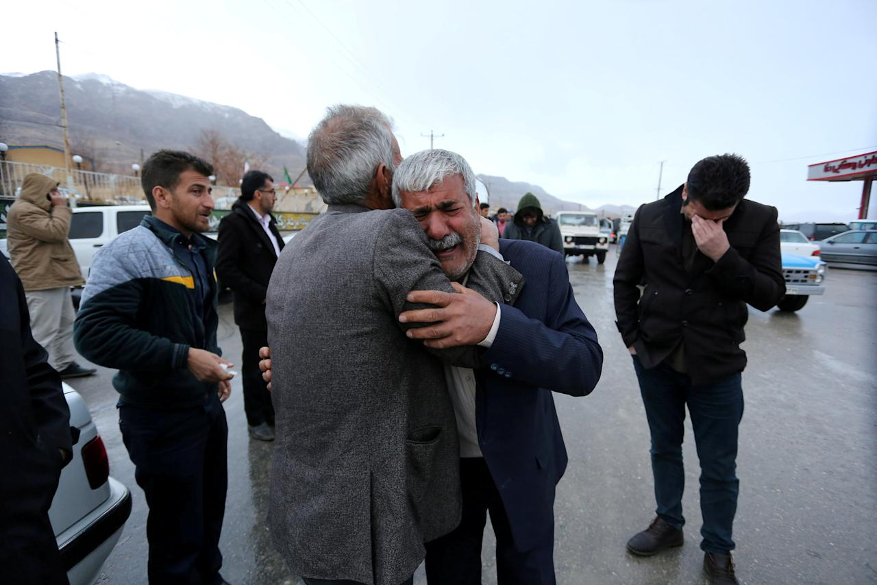Relatives of passengers who were believed to have been killed in a plane crash react near the town of Semirom, Iran, February 18, 2018. REUTERS/Tasnim News Agency  ATTENTION EDITORS - THIS PICTURE WAS PROVIDED BY A THIRD PARTY.     TPX IMAGES OF THE DAY