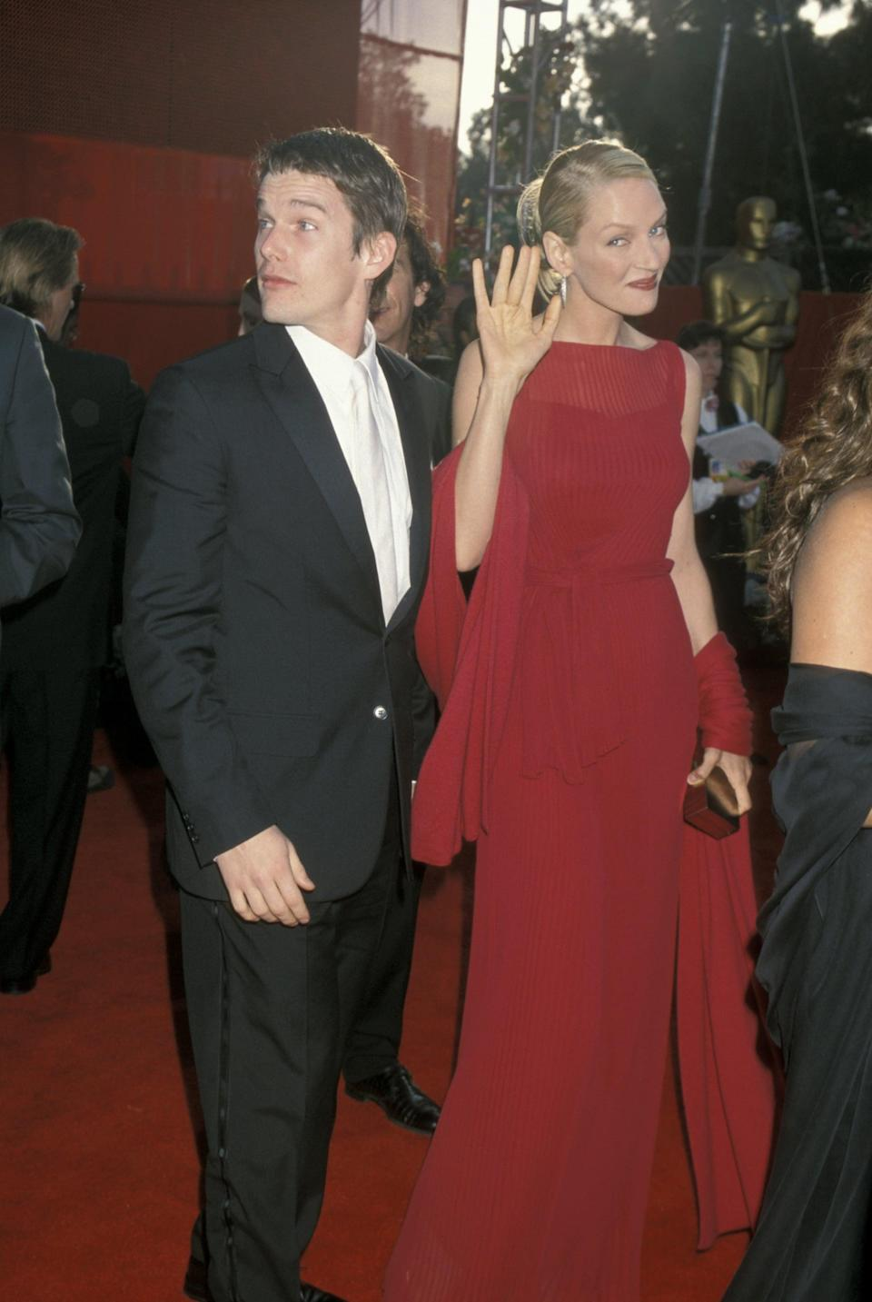 <p>Though it was nearly the same color as the red carpet, this Alberta Ferretti gown stood out at the 2000 Oscars.</p>