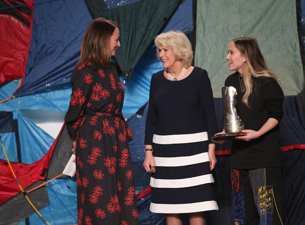 <p>The Duchess of Cornwall re-wore a black and white striped dress and pearl choker while presenting Bethany Williams with the Queen Elizabeth II Award for British Design at London Fashion Week. </p>
