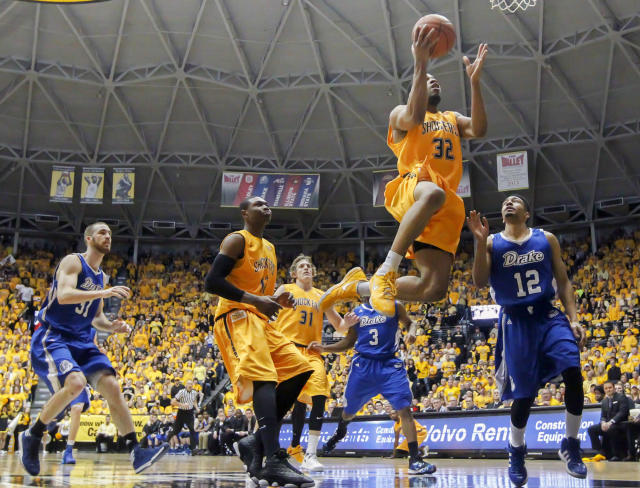 Wichita State's Tekele Cotton drives to the basket against Drake, during the second half of an NCAA basketball game, Saturday, Feb. 22, 2014 in Wichita, Kan. (AP Photo/The Wichita Eagle, Fernando Salazar) LOCAL TV OUT; MAGS OUT; LOCAL RADIO OUT; LOCAL INTERNET OUT