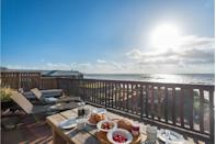 """<p>This sea front cottage has views from living room to terrace and is located just a minute walk from the Cornish beach. </p><p>The pièce-de-résistance of the property is, undoubtedly, its decked terrace, which is perfect for garden breakfasts and late-night card games, in addition to its BBQ area. </p><p>With high ceilings, a spiral staircase and open-plan design, this is the perfect weekend cottage for friends wanting to chill out. </p><p><strong>Cottage for eight people from £1,033</strong></p><p><a class=""""link rapid-noclick-resp"""" href=""""https://go.redirectingat.com?id=127X1599956&url=https%3A%2F%2Fwww.toadhallcottages.co.uk%2Fholiday-cottages%2Fbayview%2F3071&sref=https%3A%2F%2Fwww.elle.com%2Fuk%2Flife-and-culture%2Fculture%2Fg33261665%2Fcoastal-cottages%2F"""" rel=""""nofollow noopener"""" target=""""_blank"""" data-ylk=""""slk:BOOK ONLINE"""">BOOK ONLINE</a> </p>"""
