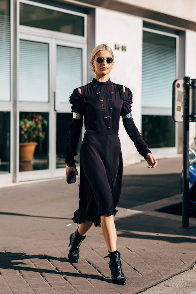 <p>Add volume to a collared black dress with ankle boots that have straps or buckles.</p>