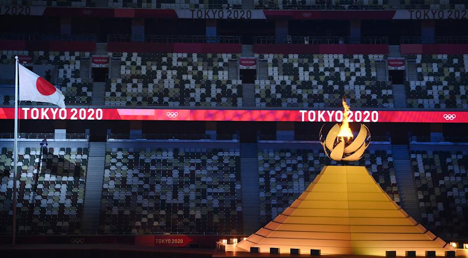 Empty seats are seen as the Olympic Flame burns after the lighting of the Olympic Cauldron during the opening ceremony of the Tokyo 2020 Olympic Games, at the Olympic Stadium, in Tokyo, on July 23, 2021. (Photo by Franck FIFE / AFP) (Photo by FRANCK FIFE/AFP via Getty Images)