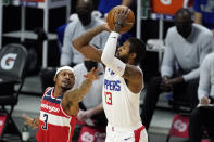 Los Angeles Clippers guard Paul George, right, shoots as Washington Wizards guard Bradley Beal defends during the first half of an NBA basketball game Tuesday, Feb. 23, 2021, in Los Angeles. (AP Photo/Mark J. Terrill)