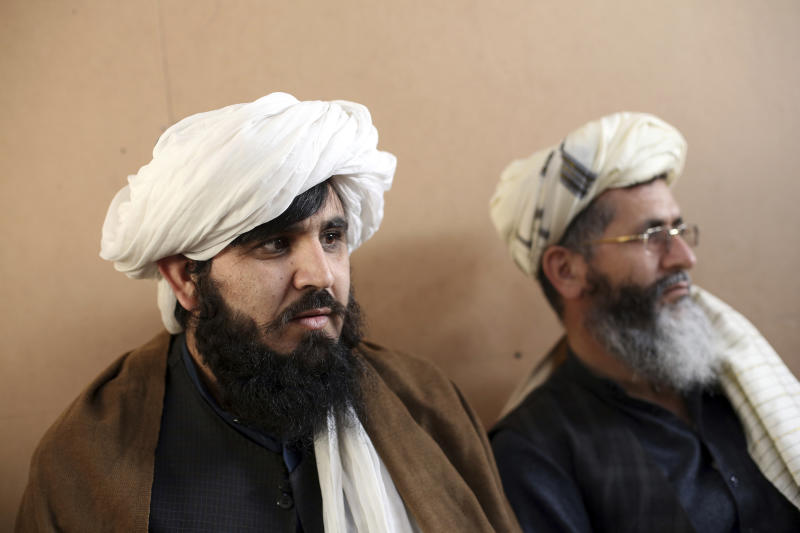 FILE- In this Dec. 14, 2019, file photo, jailed Taliban are seen after an interview with The Associated Press inside the Pul-e-Charkhi jail in Kabul, Afghanistan. After a series of delays, Afghan President Ashraf Ghani issued a decree early Wednesday, March 11, 2020, promising to release 1,500 Taliban prisoners as a goodwill gesture to get intra-Afghan negotiations started, even though a deal signed by the United States and the Taliban calls for the release of up to 5,000 prisoners ahead of the much sought after negotiations. (AP Photo/Rahmat Gul, File)