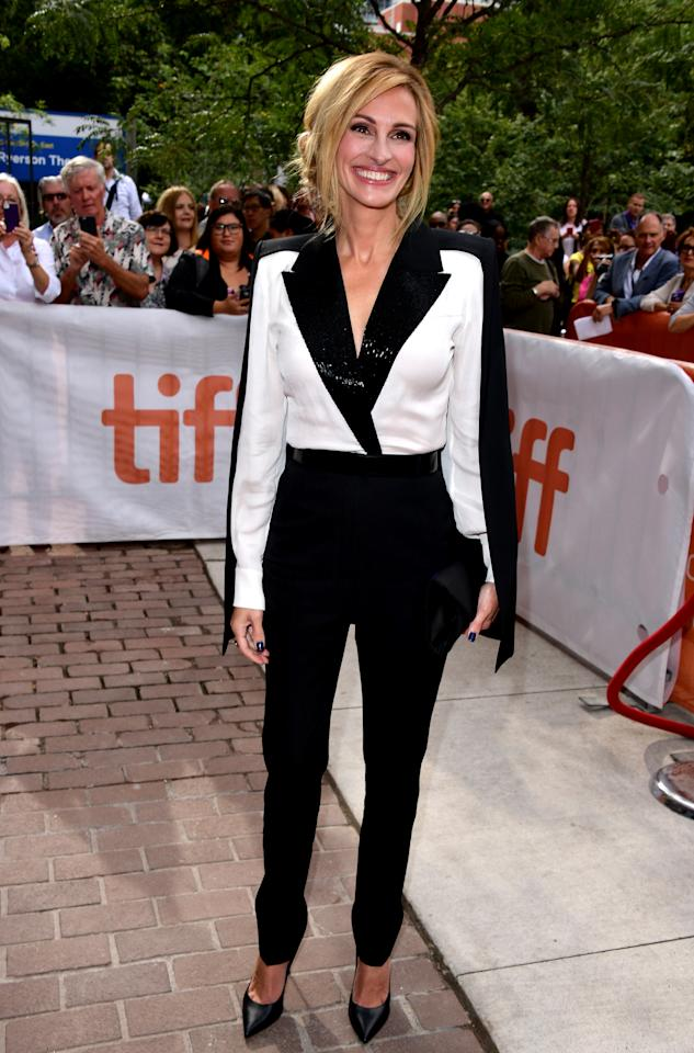 "<p>Roberts accessorized her monochrome Givenchy tuxedo with her infamous mega watt smile as she promoted her new Amazon series, ""Homecoming."" </p>"